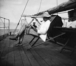 Man in Tropical Gear in Deckchair on Deck of Ship