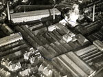 Aerial photograph showing Walton Works, Logie Works, Edward Street Mill, Larchfield Works, Blackness Foundry and Queen Victoria Works, Dundee, 11 December 1922