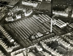 Aerial photograph showing Caldrum Works and Dens Road School, Dundee, 11 December 1922