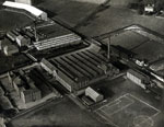 Aerial photograph showing Angus Jute Works, Densfield Works and Dens Road School, Dundee, 8 December 1922
