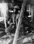 Young soldier surrounded by icicles, France, during World War I