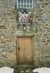 Detail of entrance doorway and armorial, main south building, Round Square, Gordonstoun House, Moray
