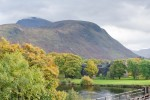General view of Inverlochy Castle with the River Lochy in the foreground and Ben Nevis in the background